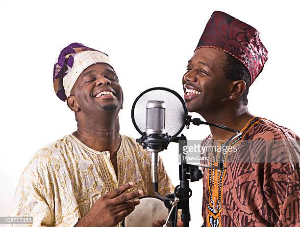West African Musicians Singing and Laughing
