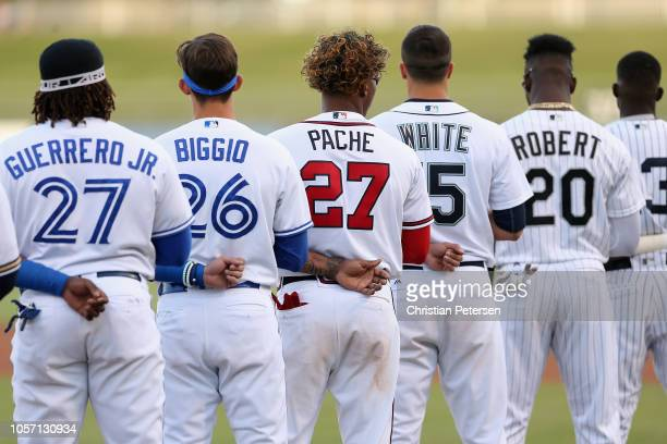 West AllStar Cristian Pache of the Atlanta Braves tstands attended for the national anthem with teammates before the Arizona Fall League All Star...