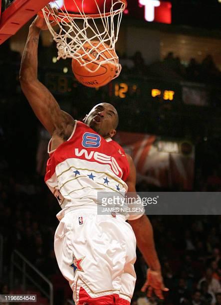 West allstar Kobe Bryant slam dunks the ball during the second half of the 2006 NBA AllStar game at the Toyota Center in Houston Texas 19 February...