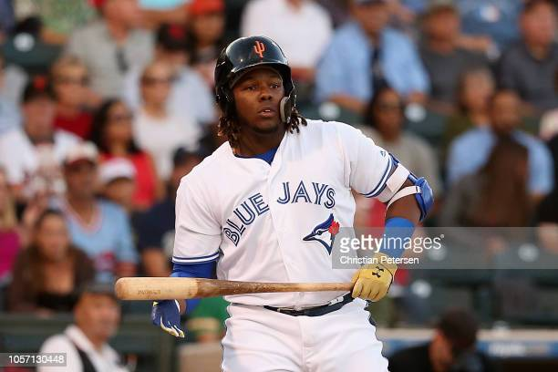 West AllStar Vladimir Guerrero Jr of the Toronto Blue Jays reacts as he bats during the Arizona Fall League All Star Game at Surprise Stadium on...