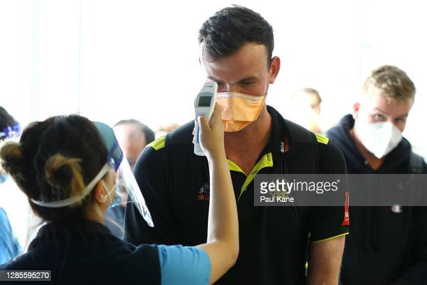 West Australian cricket player Ashton Turner has his temperature checked prior to G2G verification by West Australian police after arriving from...