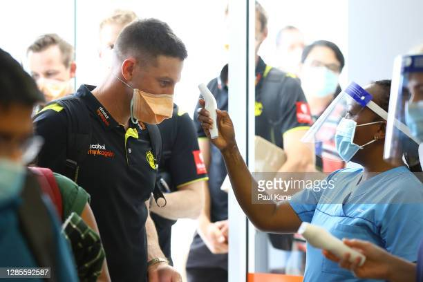 West Australian cricket player Shaun Marsh has his temperature checked prior to G2G verification after arriving from Adelaide on Qantas flight QF889...