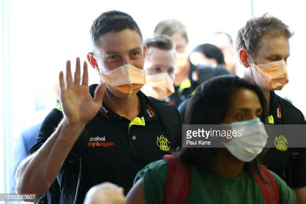 West Australian cricket player Shaun Marsh waves to waiting family members prior to G2G verification after arriving from Adelaide on Qantas flight...