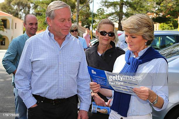 West Australian Premier Colin Barnett looks on as Deputy Leader of the Opposition Julie Bishop looks at a how to vote card at the Cottesloe Civic...