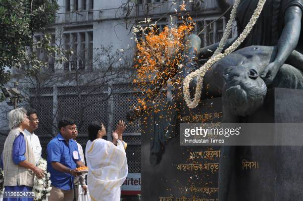 West Bengal Chief Minister Mamata Banerjee along with other dignitaries pays floral tribute at the Bhasha Shahid Memorial monument on the occasion of...
