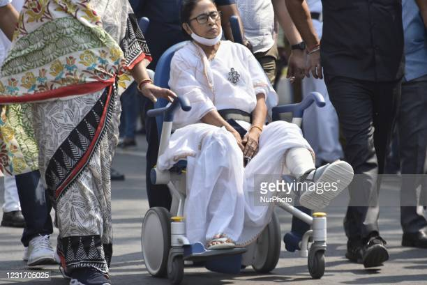 West Bengal chief minister Mamata Banerjee attends a rally of Trinamool Congress on a wheel chair as she was injured on her leg, before West Bengal...