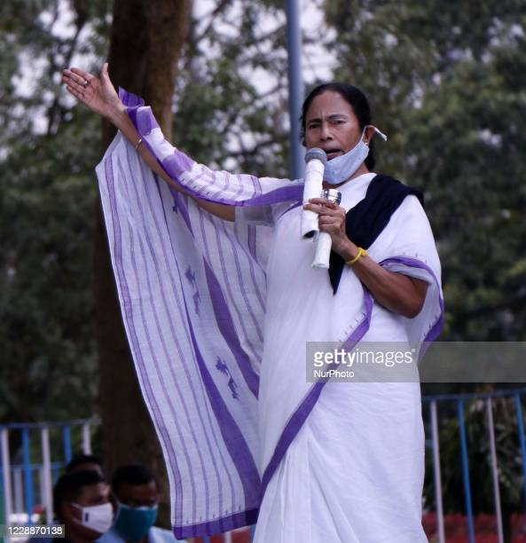West Bengal Chief Minister Mamata Banerjee deliver her speech during a protest rally against the death of a 19-year-old Dalit woman who was allegedly...