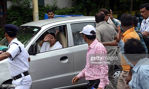 West Bengal Chief Minister Mamata Banerjee greets people as her Maruti car passes after her oath taking ceremony on May 27 2016 in Kolkata India The...