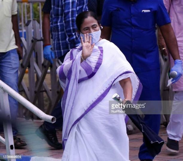 West Bengal Chief Minister Mamata Banerjee leads a protest rally against the death of a 19-year-old Dalit woman who was allegedly gang-raped at...
