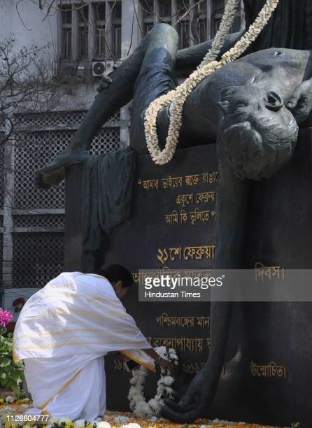 West Bengal Chief Minister Mamata Banerjee pays floral tribute at the Bhasha Shahid Memorial monument on the occasion of International Mother...