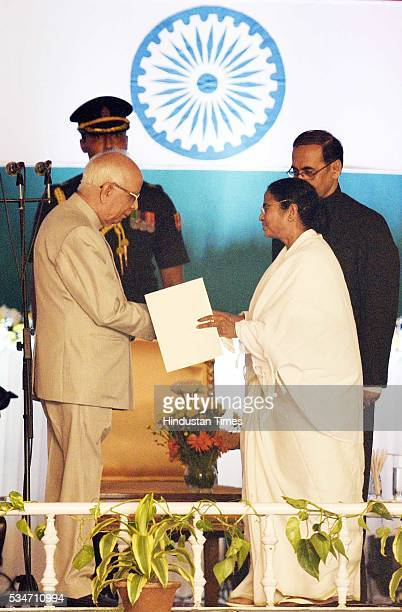 West Bengal Chief Minister Mamata Banerjee shaking hands with the Governor Kesri Nath Tripathi after taking oath at Red Road on May 27 2016 in...
