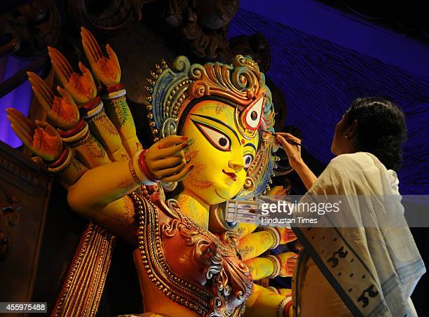 West Bengal Chief Minister Mamata Banerjee sketches the eyes of Goddess Durga on the auspicious day of Mahayala at Chetla Agrani Club on September 23...
