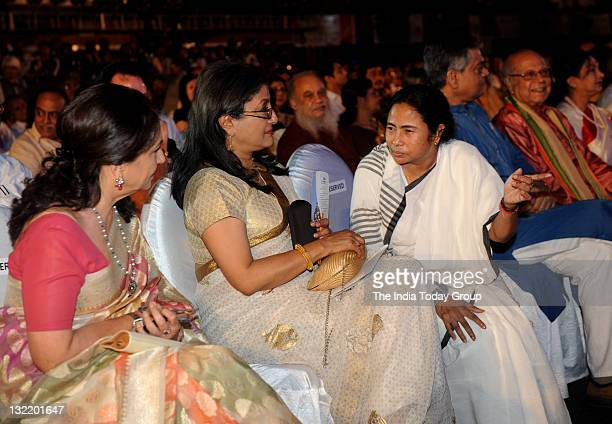 West Bengal chief minister Mamata Banerjee talks to Aparna Sen and Sharmila Tagore during the inaugural of 17th Kolkata film festival in Kolkata on...