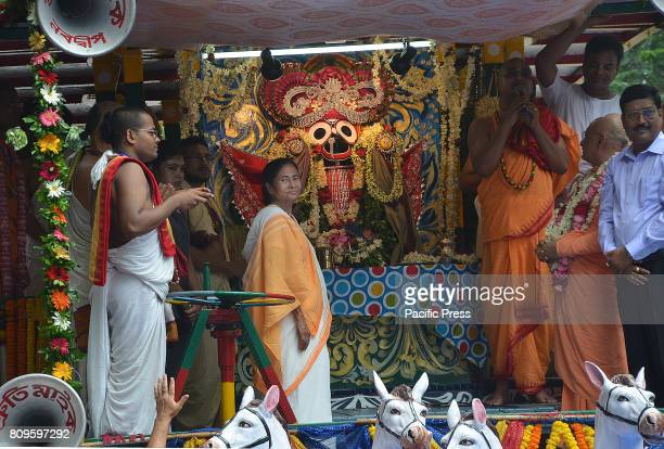 West Bengal Chief Minister Mamata Banerjee with ample of devotees take part on pulling the chariot of lord Jagannath of Iskon on the auspicious day...
