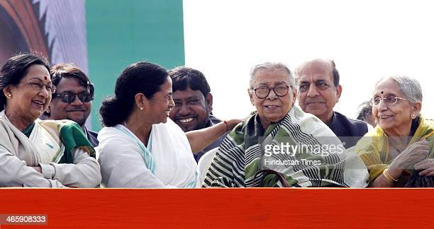 West Bengal Chief Minister Mamata Banerjee with Mahasweta Devi during the Trinamool Congress rally at Brigade Parade Ground on January 30 2014 in...