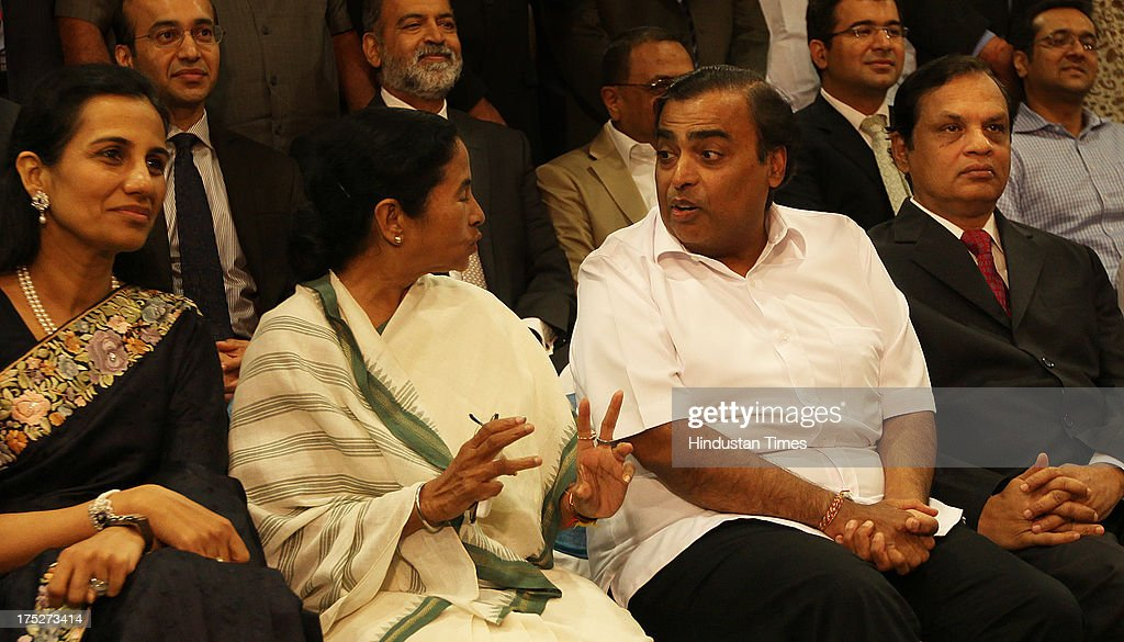 West Bengal Chief Minister Mamata Banerjee with Reliance Industry Chairman Mukesh Ambani, Chanda Kochhar of ICICI, Venugopal Dhoot of Videocon during the investors summit at World Trade Centre on August 1, 2013 in Mumbai, India. Ms Banerjee met with about 40 top industry leaders and said that West Bengal is now more investment friendly as the work culture has improved and the number of manhours lost due to strikes has declined. She also said that West Bengal government has framed a detailed land use policy and created a 10,000 acre land-bank for industrial purposes apart from creating 'an employment bank'.