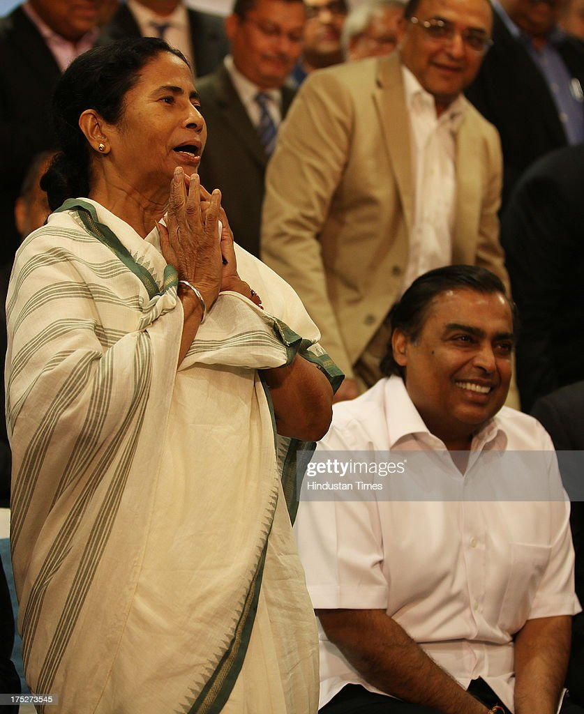 West Bengal Chief Minister Mamata Banerjee with Reliance Industry Chairman Mukesh Ambani during the investors summit at World Trade Centre on August 1, 2013 in Mumbai, India. Ms Banerjee met with about 40 top industry leaders and said that West Bengal is now more investment friendly as the work culture has improved and the number of manhours lost due to strikes has declined. She also said that West Bengal government has framed a detailed land use policy and created a 10,000 acre land-bank for industrial purposes apart from creating 'an employment bank'.