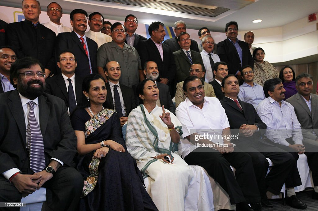 West Bengal Chief Minister Mamata Banerjee with top Indian industrialist and corporate leaders including Reliance Industry Chairman Mukesh Ambani, Chanda Kochhar of ICICI, Venugopal Dhoot of Videocon during the investors summit at World Trade Centre on August 1, 2013 in Mumbai, India. Ms Banerjee met with about 40 top industry leaders and said that West Bengal is now more investment friendly as the work culture has improved and the number of manhours lost due to strikes has declined. She also said that West Bengal government has framed a detailed land use policy and created a 10,000 acre land-bank for industrial purposes apart from creating 'an employment bank'.
