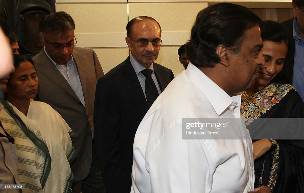 West Bengal Chief Minister Mamata Banerjee with top Indian industrialist and corporate leaders including Reliance Industry Chairman Mukesh Ambani, Chanda Kochhar of ICICI and Adi Godrej during the investors summit at World Trade Centre on August 1, 2013 in Mumbai, India. Ms Banerjee met with about 40 top industry leaders and said that West Bengal is now more investment friendly as the work culture has improved and the number of manhours lost due to strikes has declined. She also said that West Bengal government has framed a detailed land use policy and created a 10,000 acre land-bank for industrial purposes apart from creating 'an employment bank'.