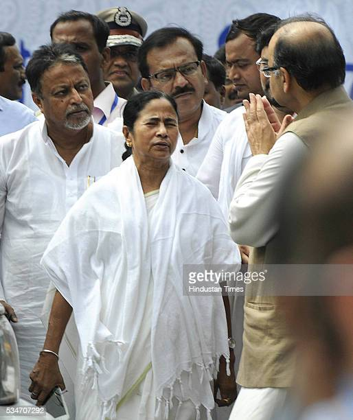 West Bengal Chief Minister Mamata Banerjee with Union Finance Minister Arun Jaitley during her swearing-in ceremony at Red Road on May 27, 2016 in...