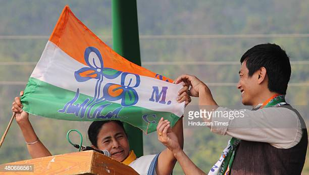 West Bengal Chief Minister Mamata Benerjee and Darjeeling candidate Bhaichung Bhutia showing the TMC flag to public during the election rally at...