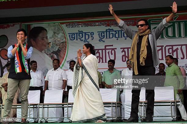 West Bengal Chief Minister Mamata Benerjee Darjeeling candidate Bhaichung Bhutia and Bollywood actor and Rajaya Sabha MP Mithun Chakrobarty gestures...