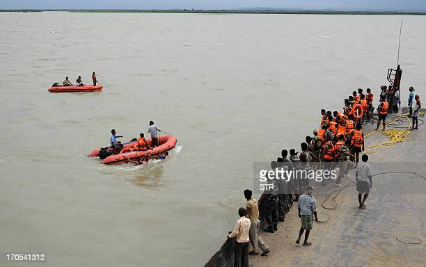 A West Bengal Disaster Management rescue team conduct a rescue operation at the River Ganges following the capsizing of a ferry carrying passengers...