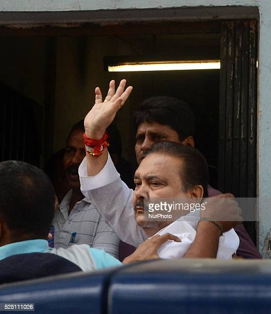 West Bengal transport minister Madan Mitra waves during the production in court on December 17 2014 in Kolkata India