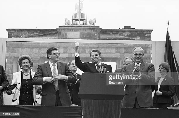 President Reagan gives a thumbs up sign after speaking at the Brandenburg Gate today With him is West German Chancellor Helmut Kohl and Phillip...