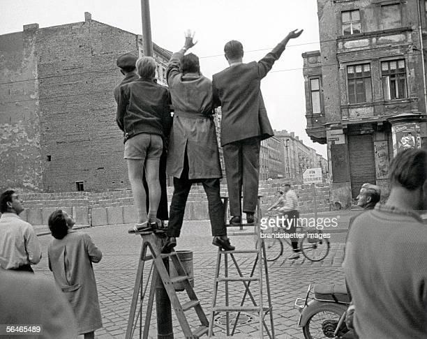West Berlin Inhabitants are waving at the newly erected Berlin Wall Photography 1961 [Menschen in West Berlin winken ueber die neu errichtete...