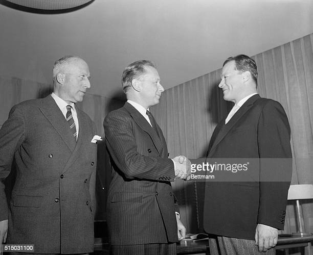 West Berlin Mayor Willy Brandt right is greeted by United Nations Secretary General Dag Hammarskjold in the Secretary General's office at United...