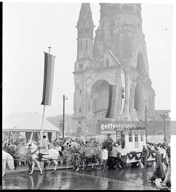 West Berliners cheer as white stallions draw a float to the entrance of the GedachtniskircheThe Memorial Church towering landmark that was badly...