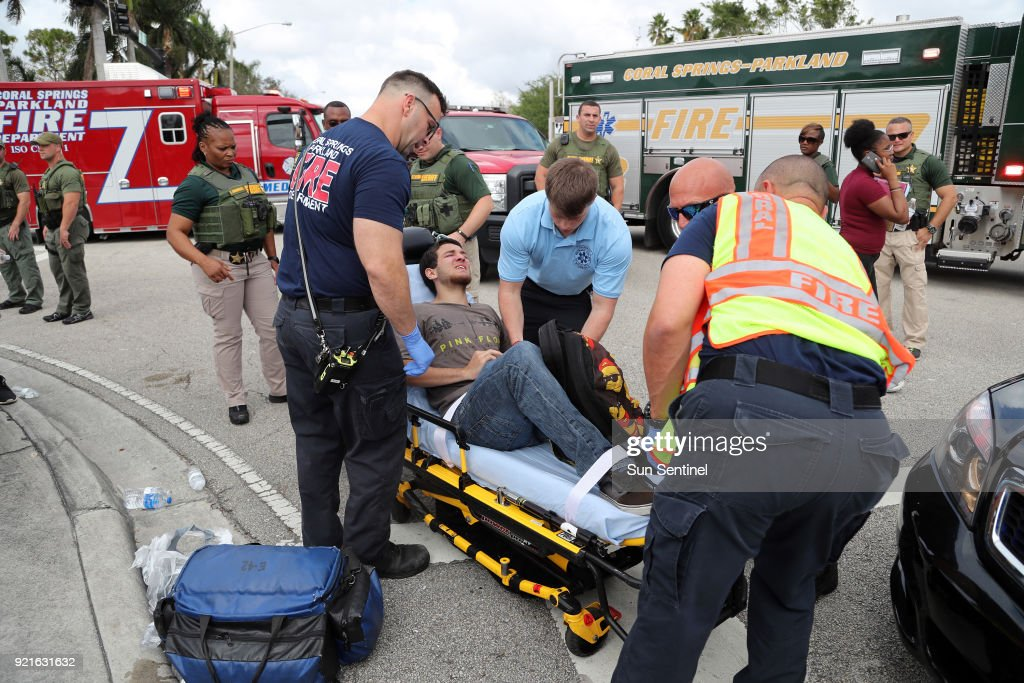 A West Boca Raton Community High School student is transported after walking to Marjory Stoneman Douglas High School in Parkland, Fla. on Tuesday, Feb. 20, 2018.