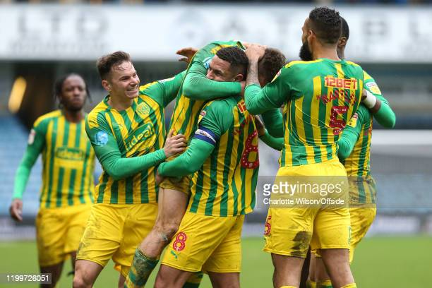 West Brom captain Jake Livermore hugs goalscorer Dara O'Shea as they celebrate their 2nd goal with the rest of the team during the Sky Bet...