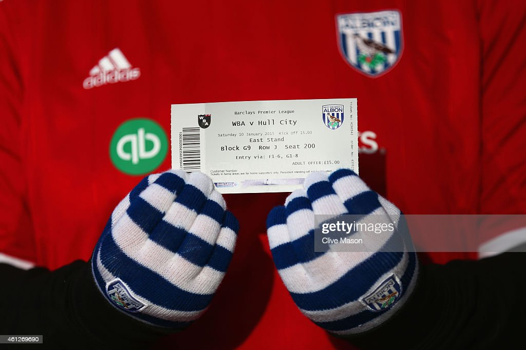 A West Brom fan shows a match ticket prior to the Barclays Premier League match between West Bromwich Albion and Hull City at The Hawthorns on January 10, 2015 in West Bromwich, England.