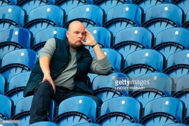 A West Brom fan waits for kick off of the English Premier League football match between West Bromwich Albion and Liverpool at The Hawthorns stadium...