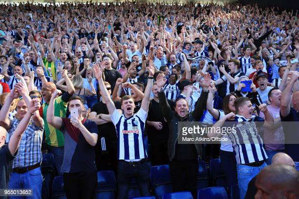 West Brom fans celebrate the late goal during the Premier League match between West Bromwich Albion and Tottenham Hotspur at The Hawthorns on May 5...