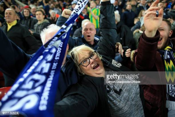 West Brom fans celebrate victory during The Emirates FA Cup Fourth Round match between Liverpool and West Bromwich Albion at Anfield on January 27...