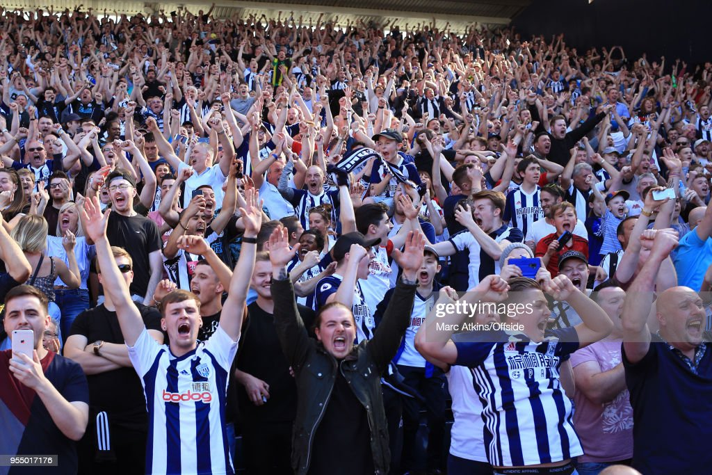 West Brom fans react to an injury time goal from Jake Livermore during the Premier League match between West Bromwich Albion and Tottenham Hotspur at The Hawthorns on May 5, 2018 in West Bromwich, England.