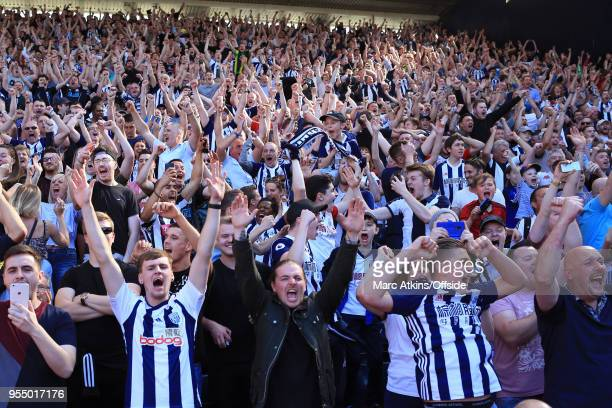 West Brom fans react to an injury time goal from Jake Livermore during the Premier League match between West Bromwich Albion and Tottenham Hotspur at...