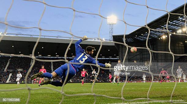 West Brom goalkeeper Boaz Myhill is beaten by Peterborough player Jon Taylor for the second Peterborough goal during The Emirates FA Cup Fourth Round...