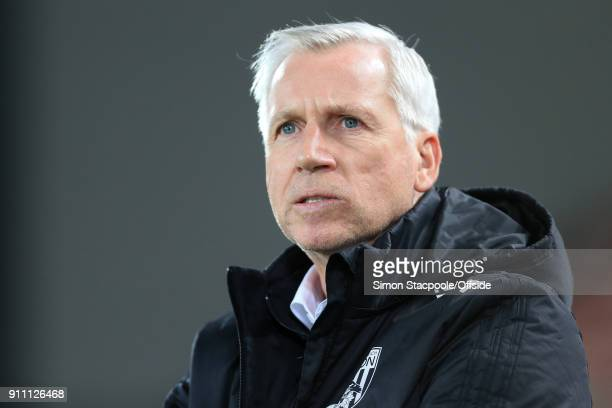 West Brom manager Alan Pardew looks on during The Emirates FA Cup Fourth Round match between Liverpool and West Bromwich Albion at Anfield on January...