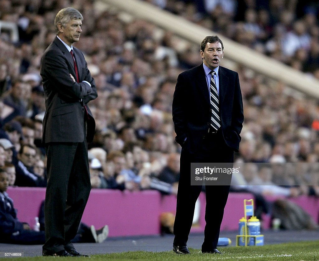 West Brom manager Bryan Robson urges on his team as Arsene Wenger