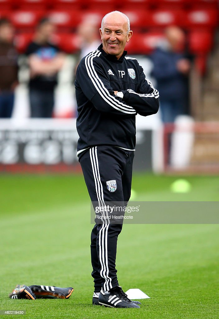 West Brom manager Tony Pulis takes the warm up before the Pre-Season Friendly between Walsall and West Bromwich Albion at Banks' Stadium on July 28, 2015 in Walsall, England.