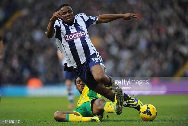 West Brom player Victor Anichebe is tackled by Norwich player Leroy Fer during the Barclays Premier League match between West Bromwich Albion and...
