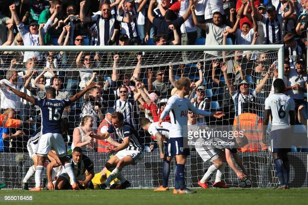 West Brom players celebrate with Jake Livermore after he scores an injury time goal during the Premier League match between West Bromwich Albion and...