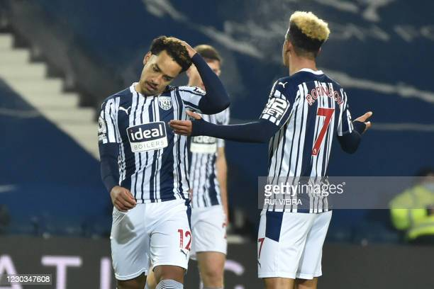 West Brom players react after conceding their fifth goal during the English Premier League football match between West Bromwich Albion and Leeds...