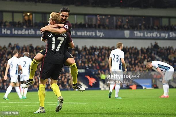 West Brom players react as Manchester City's German midfielder Ilkay Gundogan leaps into the arms of Manchester City's Belgian midfielder Kevin De...