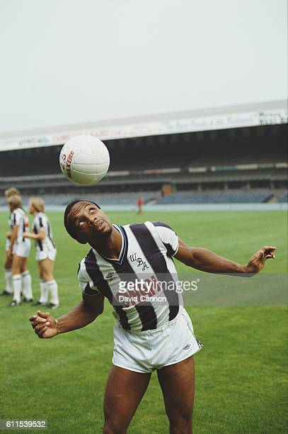 West Bromwich Albion and England striker Cyrille Regis in action during a photocall circa 1984 at the Hawthorns in 1984 in West Bromwich England