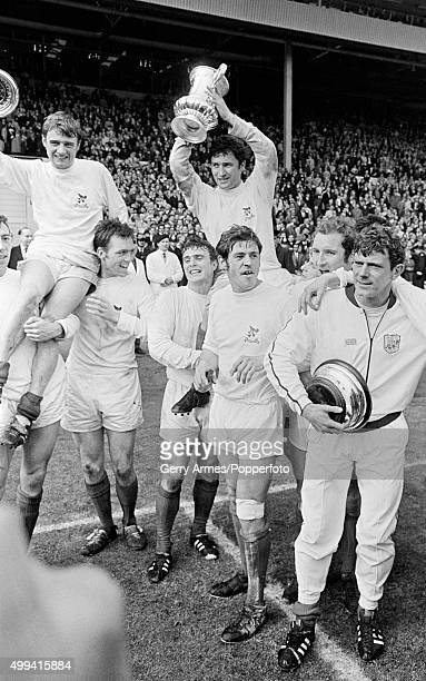 West Bromwich Albion captain Graham Williams holds the trophy aloft after the FA Cup Final between West Bromwich Albion and Everton at Wembley...